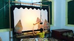 And the backstage view of a Javanese puppet show.